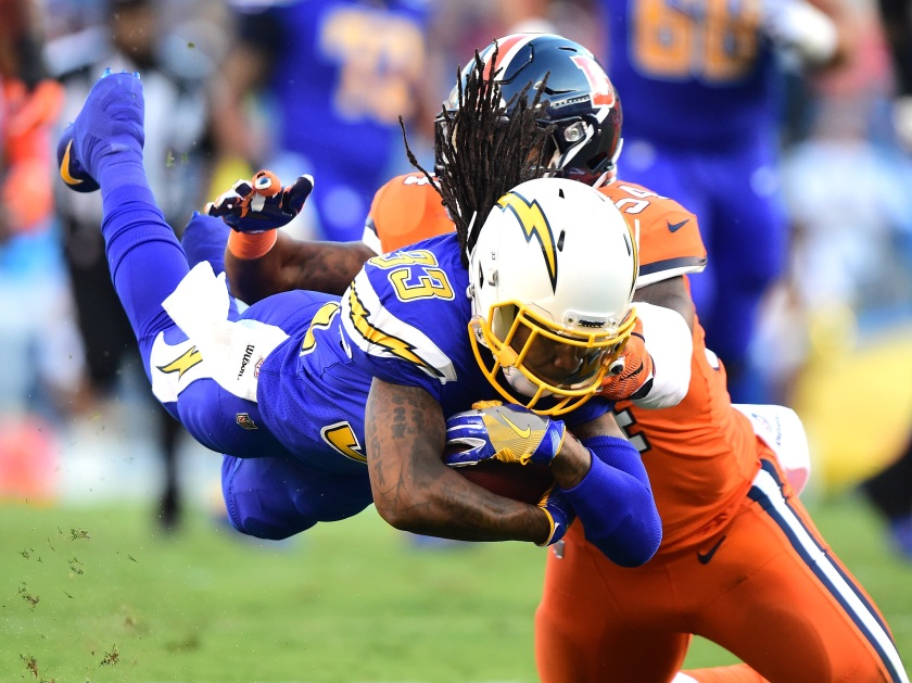 Dexter McCluster #33 of the San Diego Chargers dives with the ball as he is tackle by Brandon Marshall #54 of the Denver Broncos during the first quarter at Qualcomm Stadium on October 13, 2016 in San Diego, California. (Harry How/Getty Images)