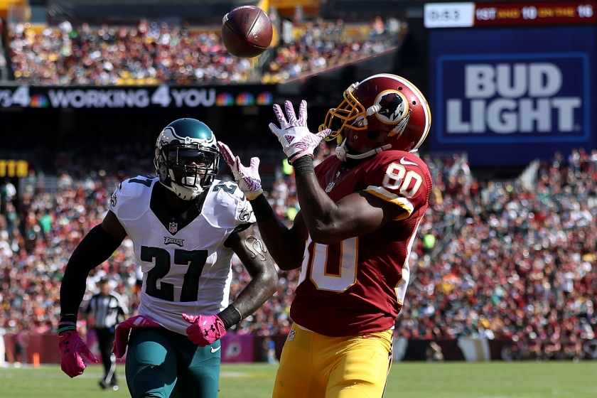 Wide receiver Jamison Crowder #80 of the Washington Redskins scores a first quarter touchdown past strong safety Malcolm Jenkins #27 of the Philadelphia Eagles at FedExField on October 16, 2016 in Landover, Maryland. (Patrick Smith/Getty Images)
