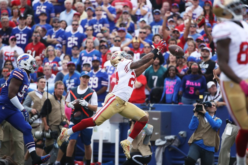 Shaun Draughn #24 of the San Francisco 49ers can't make the catch against the Buffalo BillBuffalo Billsduring the first half at New Era Field on October 16, 2016 in Buffalo, New York. (Tom Szczerbowski/Getty Images)