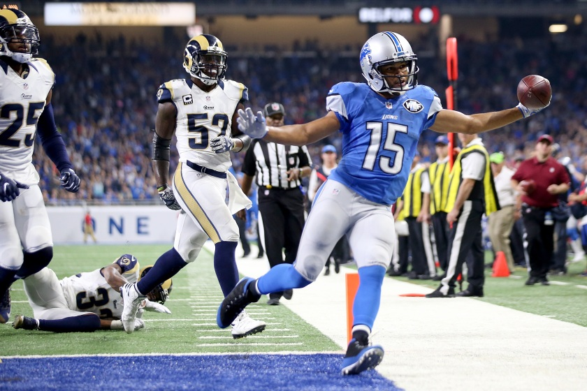 Golden Tate #15 of the Detroit Lions holds out the football after scoring a touchdown during fourth quarter action against the Los Angeles Rams at Ford Field on October 16, 2016 in Detroit, Michigan. The Detroit Lions defeated the Los Angeles Rams 31-28. (Leon Halip/Getty Images)