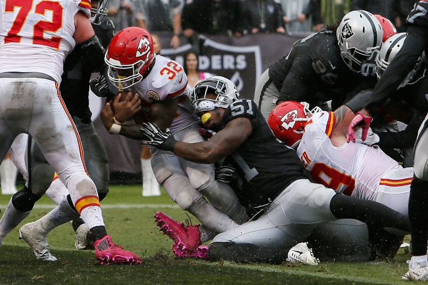 Spencer Ware #32 of the Kansas City Chiefs scores on a two-yard rush against the Oakland Raiders during their NFL game at Oakland-Alameda County Coliseum on October 16, 2016 in Oakland, California. (Brian Bahr/Getty Images)