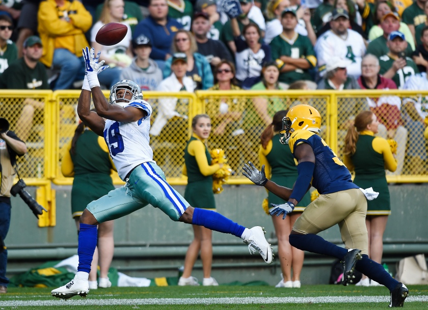 Brice Butler #19 of the Dallas Cowboys catches a touchdown pass under pressure from Micah Hyde #33 of the Green Bay Packers during the second quarter at Lambeau Field on October 16, 2016 in Green Bay, Wisconsin. (Hannah Foslien/Getty Images)