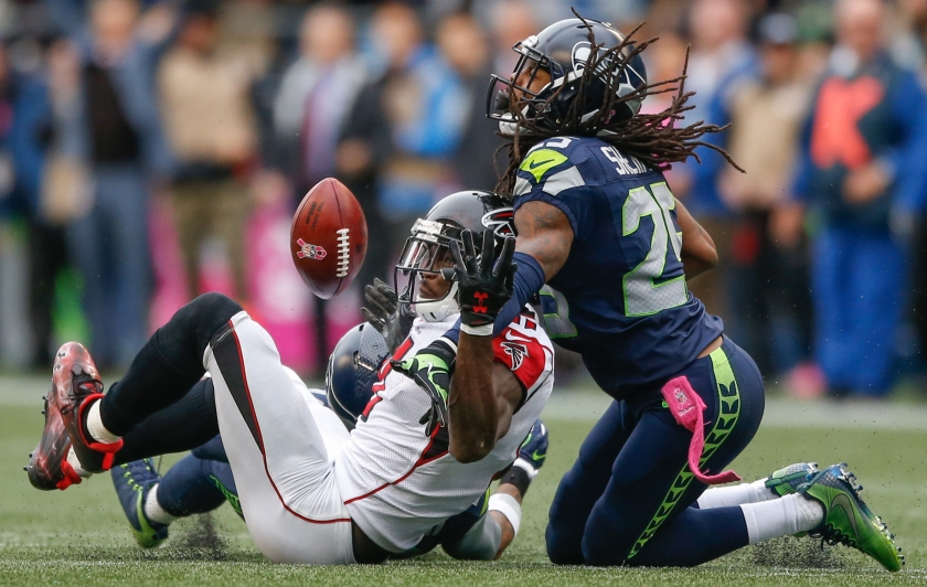 Wide receiver Julio Jones #11 of the Atlanta Falcons can't make the catch on fourth down as cornerback Richard Sherman #25 of the Seattle Seahawks defends at CenturyLink Field on October 16, 2016 in Seattle, Washington. (Otto Greule Jr/Getty Images)