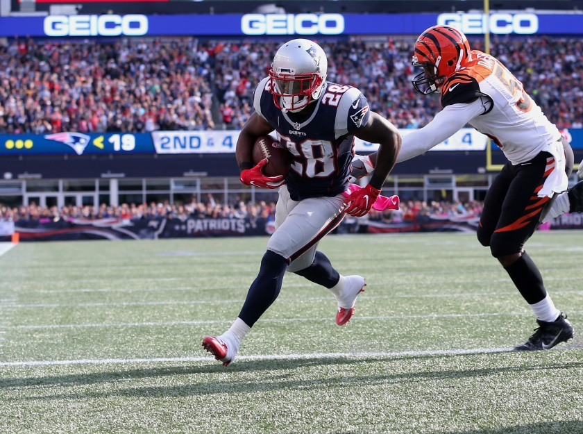 James White #28 of the New England Patriots runs in a touchdown against the Cincinnati Bengals in the third quater of the game at Gillette Stadium on October 16, 2016 in Foxboro, Massachusetts. (Jim Rogash/Getty Images)