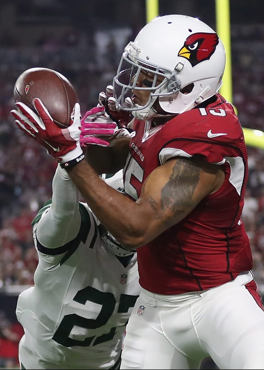 Wide receiver Michael Floyd #15 of the Arizona Cardinals makes a 9-yard touchdown reception against cornerback Darryl Roberts #27 of the New York Jets in the fourth quarter during the NFL game at the University of Phoenix Stadium on October 17, 2016 in Glendale, Arizona.  (Christian Petersen/Getty Images)