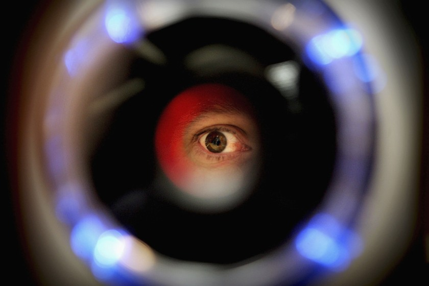 A man uses an iris recognition scanner (Ian Waldie/Getty Images)