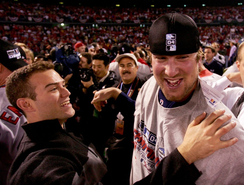 Derek Lowe #32 and general manager Theo Epstein of the Boston Red Sox celebrate after defeating the St. Louis Cardinals 3-0 in game four of the World Series on October 27, 2004 at Busch Stadium in St. Louis, Missouri. (Jed Jacobsohn/Getty Images)