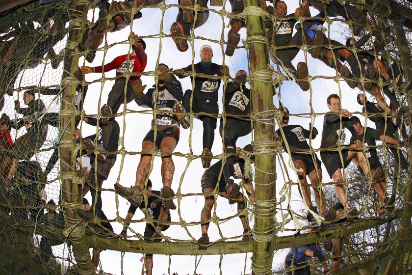 A group climbing the 40-foot ladder at Assault Course, an endurance obstacle course in Perton, England. (Bob Martin/Sports Illustrated/Getty Images)