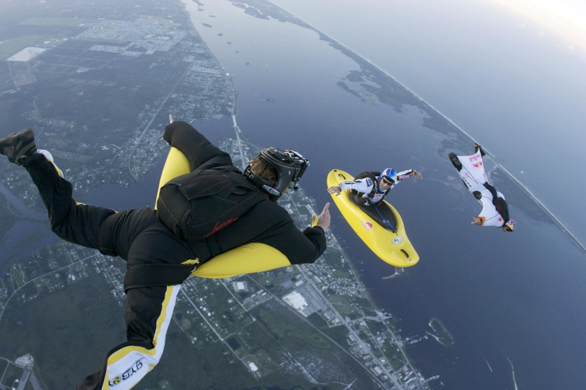 Mike Swanson is in a camera wing suit shooting two Red Cameras capturing 3D images of Miles Daisher in his Skyak while Andy Farrington flies a wing suit past Miles in Sebastian, Florida. Danger man Miles Daisher casts a bizarre image paddling across the sky - 13,000 feet up in a kayak. (Eli Thompson / Barcroft Media / Getty Images)