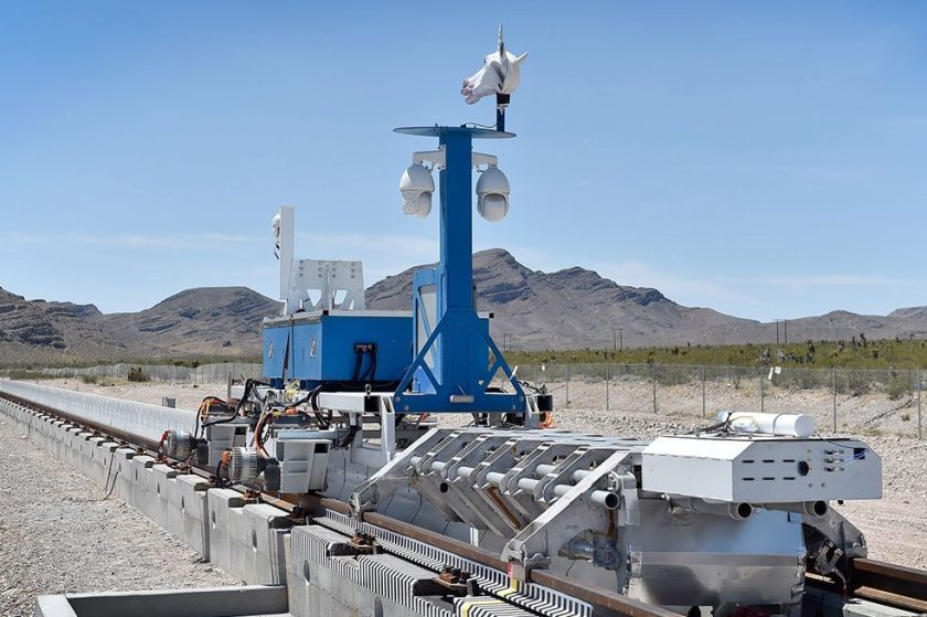 A recovery vehicle and a test sled sit on rails after the first test of the propulsion system at the Hyperloop One Test and Safety site on May 11, 2016 in North Las Vegas, Nevada. The company plans to create a fully operational hyperloop system by 2020. (David Becker/Getty Images)