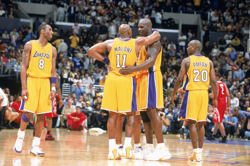 LOS ANGELES - APRIL 1: Shaquille O'Neal #34 of the Los Angeles Lakers talks with Karl Malone #11 during the game against the Houston Rockets at the Staples Center on April 1, 2004 in Los Angeles, California. The Lakers won 93-85. NOTE TO USER: User expressly acknowledges and agrees that, by downloading and/or using this Photograph, User is consenting to the terms and conditions of the Getty Images License Agreement. (Photo by Andrew D. Bernstein/NBAE via Getty Images)