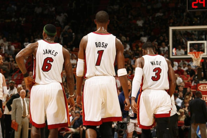 MIAMI, FL - APRIL 8: LeBron James #6, Chris Bosh #1, and Dwyane Wade #3 of the Miami Heat stand on the court during the NBA game against the Charlotte Bobcats on April 8, 2011 at American Airlines Arena in Miami, Florida. NOTE TO USER: User expressly acknowledges and agrees that, by downloading and/or using this Photograph, User is consenting to the terms and conditions of the Getty Images License Agreement. Mandatory copyright notice: Copyright NBAE 2011 (Photo by Issac Baldizon/NBAE via Getty Images)