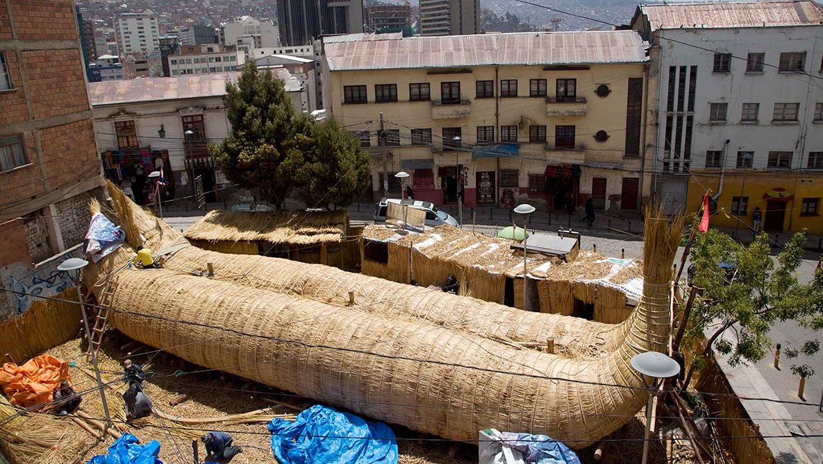 Workers continue construction of a reed boat built by Bolivian Aymara Indians in La Paz, Bolivia, Wednesday, Oct. 19, 2016. (Juan Karita/AP)