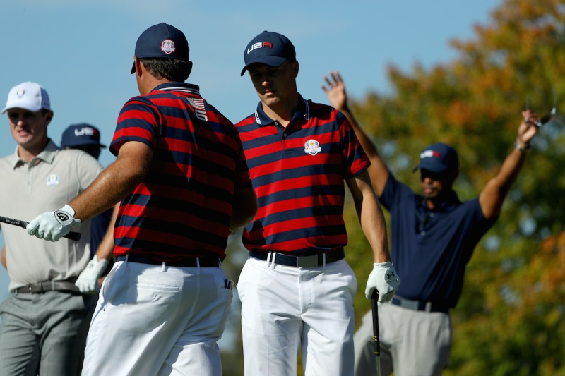 CHASKA, MN - OCTOBER 01: Patrick Reed and Jordan Spieth of the United States react on the eighth tee as vice-captain Tiger Woods looks on during afternoon fourball matches of the 2016 Ryder Cup at Hazeltine National Golf Club on October 1, 2016 in Chaska, Minnesota. (Photo by Scott Halleran/PGA of America via Getty Images)