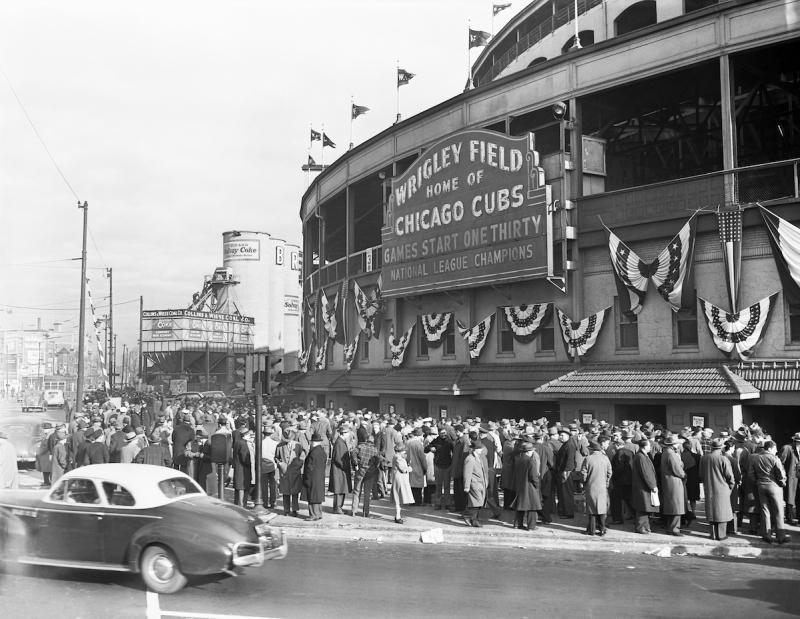 (Original Caption) 10/10/1945-Chicago, Illinois-Crowds of sports fans mill around the Wrigley Field Box Office where reserved seats for the final Tigers-Cubs World Series meet went on sale at 8 am, October 9th. Lines started forming at around 6 pm on the preceding day.