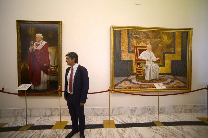 A tourist visits the Pontiffs gallery at the pope's summer residence of Castel Gandolfo on September 11, 2015. Pope Francis has recently decided to open a steam train link from the Vatican's train station to Castel Gandolfo for visitors as well as part of his summer residence. AFP PHOTO / FILIPPO MONTEFORTE = RESTRICTED TO EDITORIAL USE, MANDATORY MENTION OF THE ARTIST UPON PUBLICATION, TO ILLUSTRATE THE EVENT AS SPECIFIED IN THE CAPTION = (Photo credit should read FILIPPO MONTEFORTE/AFP/Getty Images)