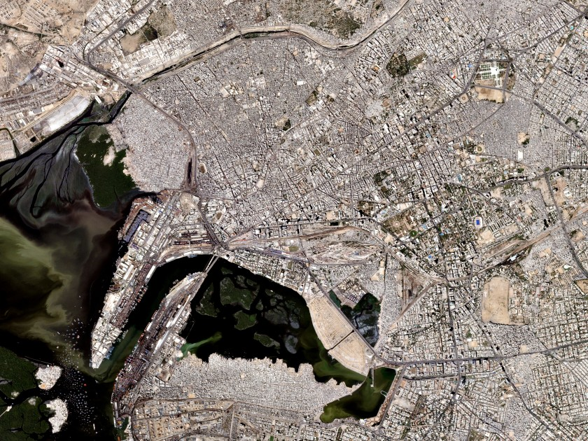 Photographed on October 10, 2016, the Karachi International Container Terminal (left) is the entrance to the largest city in Pakistan and the 7th largest city in the world. Also known as the City of The Quaid for being the birthplace and final resting place (top right) of Quaid-e-Azam Muhammad Ali Jinnah (the founder of Pakistan). (Courtesy Planet Labs)