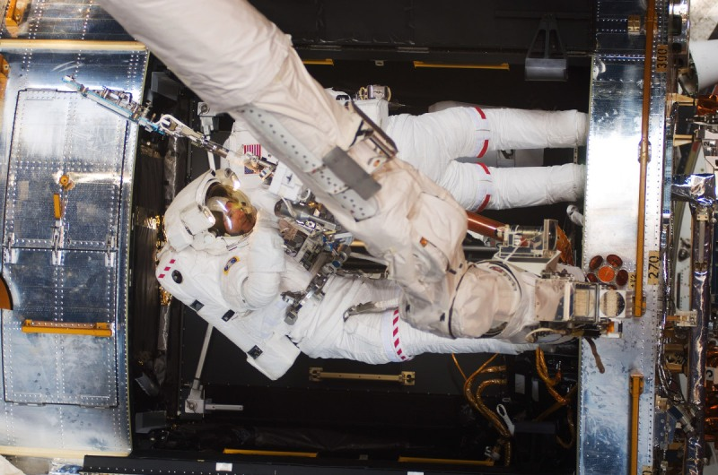 Astronauts Michael Good (bottom) and Mike Massimino, both STS-125 mission specialists, participate in the mission's fourth session of extravehicular activity (EVA) as work continues to refurbish and upgrade the Hubble Space Telescope (NASA via Getty Images)