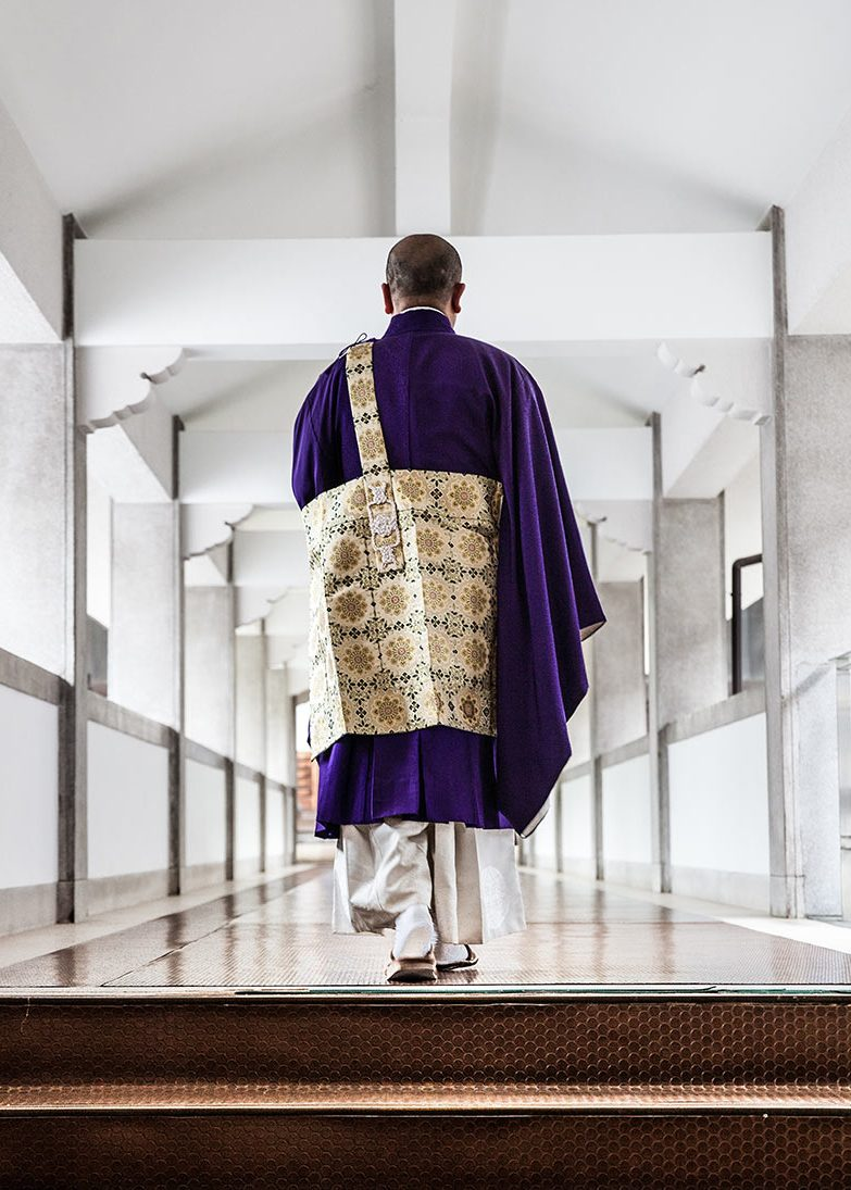Buddhist monk walking to the Temple for the pray in the morning in Chion-ji Temple, Kyoto City, Japan.