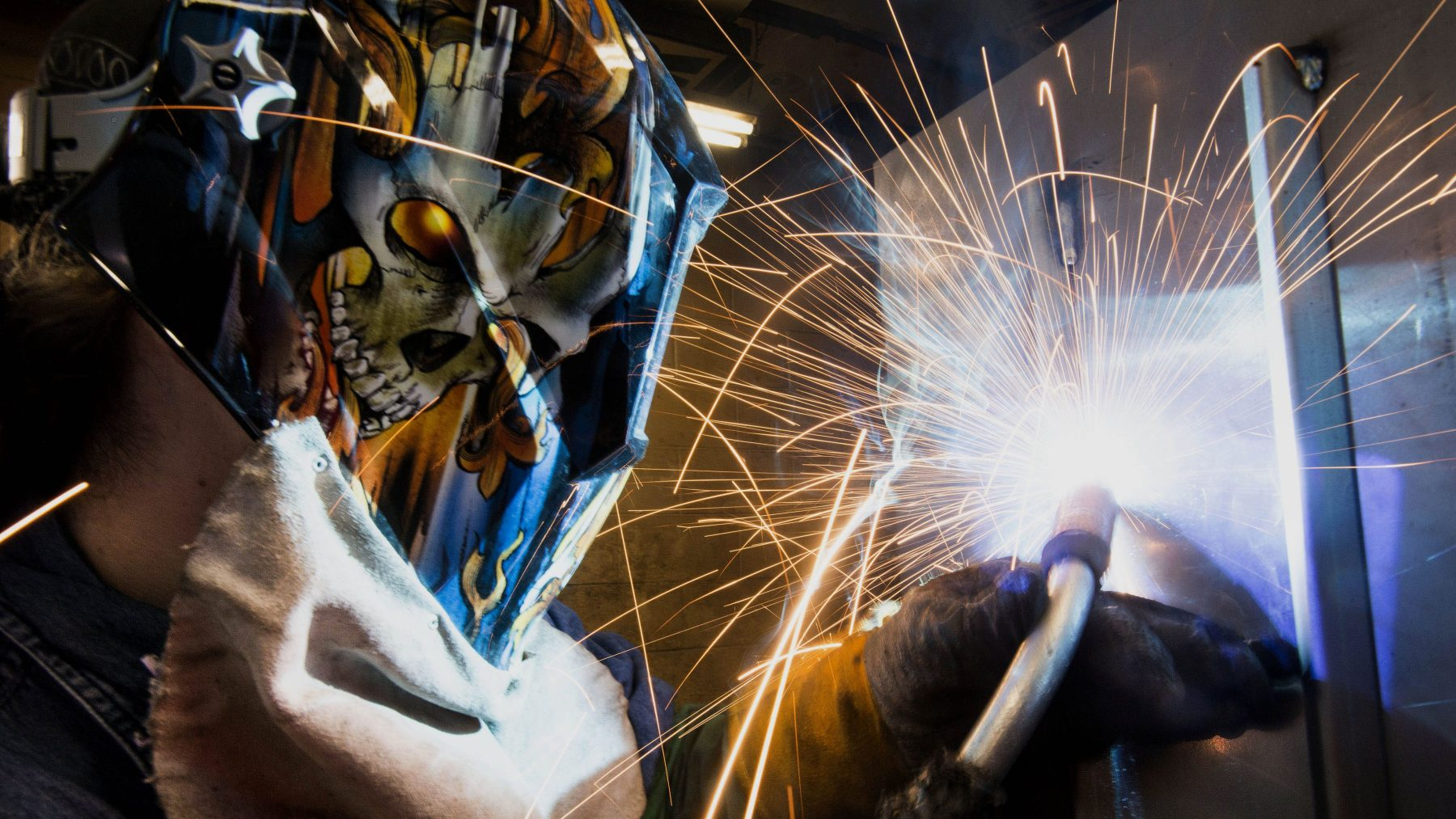 An employee uses a mig welder to create a welding beed on the inside seem of a Pioneer coal stove at the Leisure Line Stove Co. facility in Berwick, Pennsylvania, U.S., on Friday, Aug. 30, 2013. (Ty Wright/Bloomberg via Getty Images)