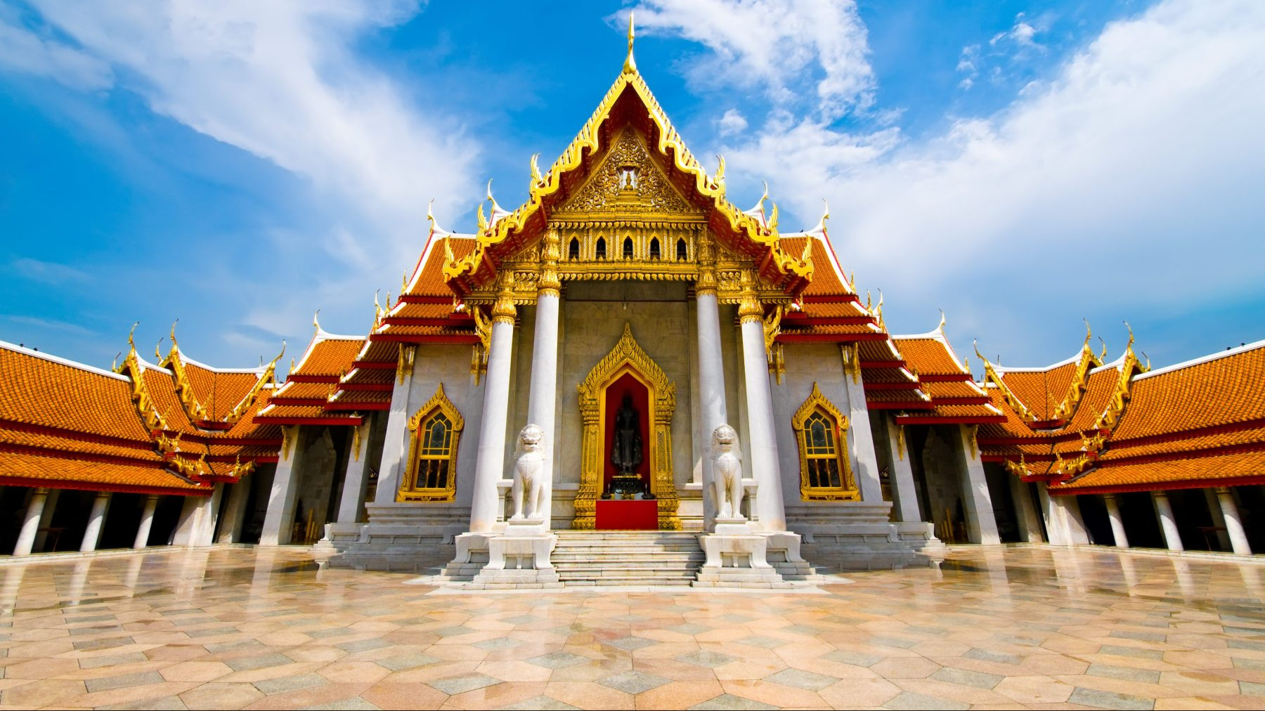 """""""The Marble Temple (Wat Benchamabophit ) Golden roof, Bangkok, Thailand. Beautiful cloudscape and blue sky over traditional Thai architecture. Each of the foreground tiles bears an image of Buddha. See more images like this in:"""""""