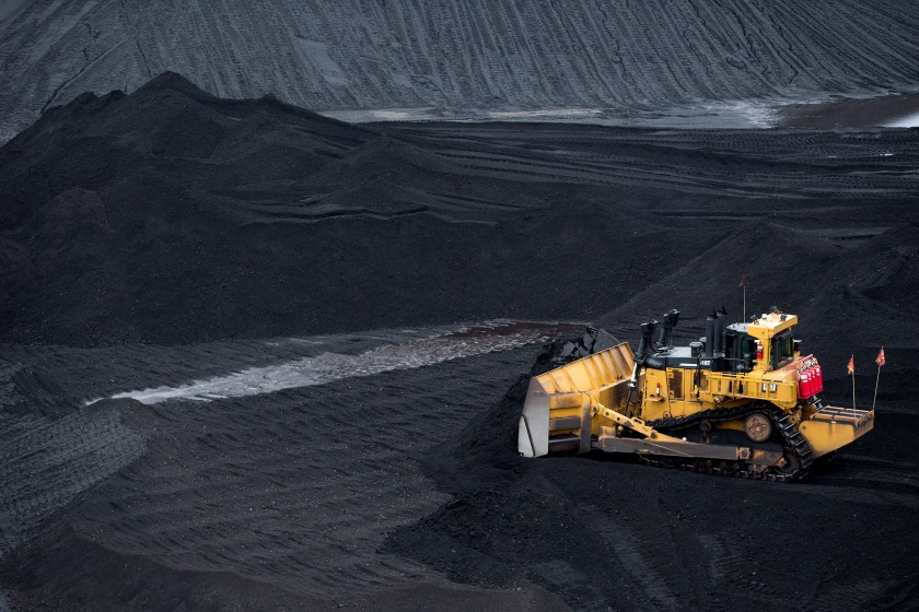A bulldozer smoothes a coal pile in the storage yard at Consol Energy Inc.'s CNX Marine Terminals Inc. coal transshipment marine terminal in Baltimore, Maryland, U.S., on Tuesday, Sept. 22, 2015. (Andrew Harrer/Bloomberg via Getty Images)