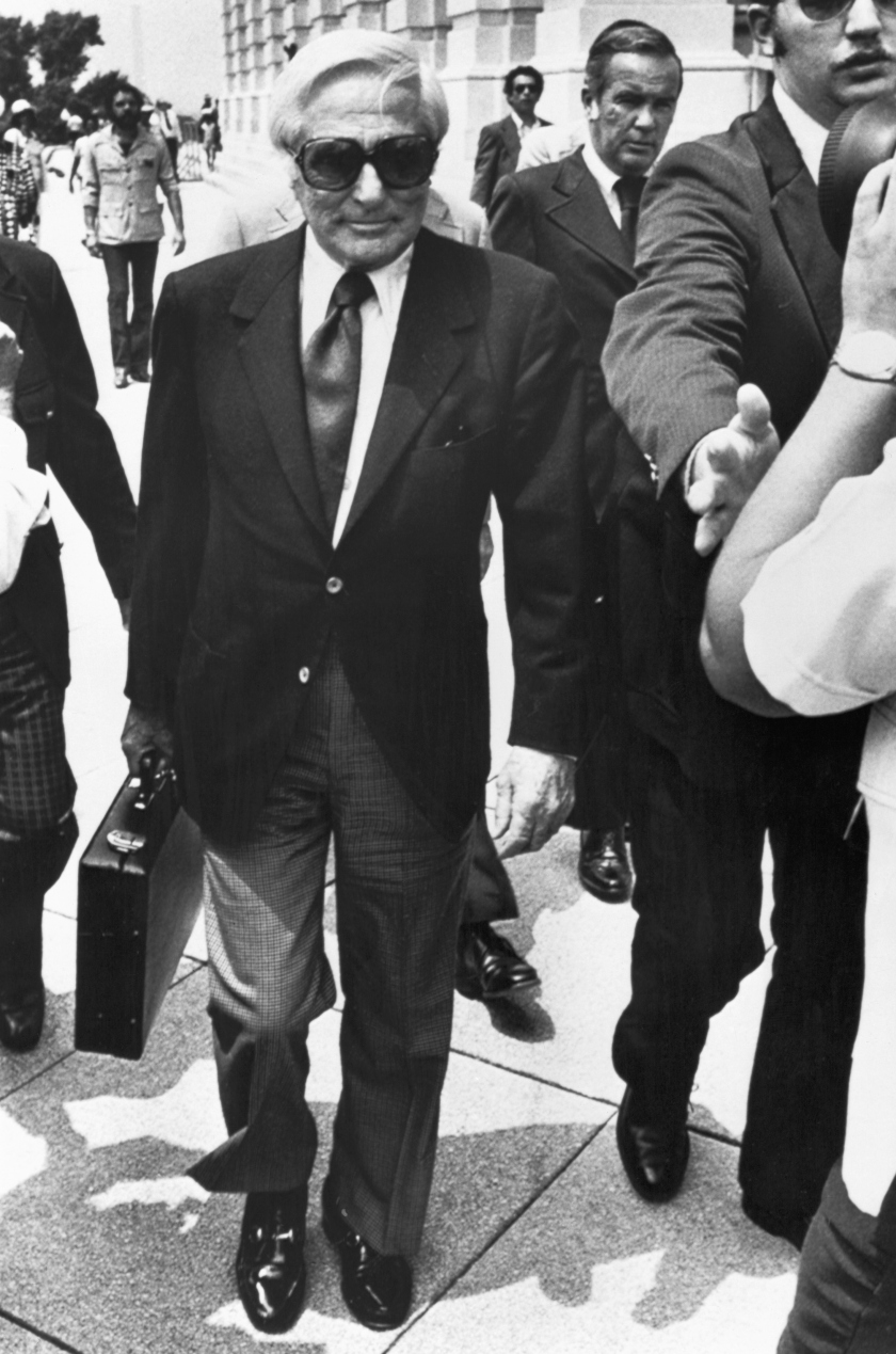 John Roselli, a reputed underworld figure from the days of Al Capone, arrives under tight security to appear before the Senate Select Committee on Intelligence to testify about his connection with the CIA and an alleged 1961 plot to assassinate Cuban Premier Fidel Castro. (Bettmann/Contributor/Getty Images)