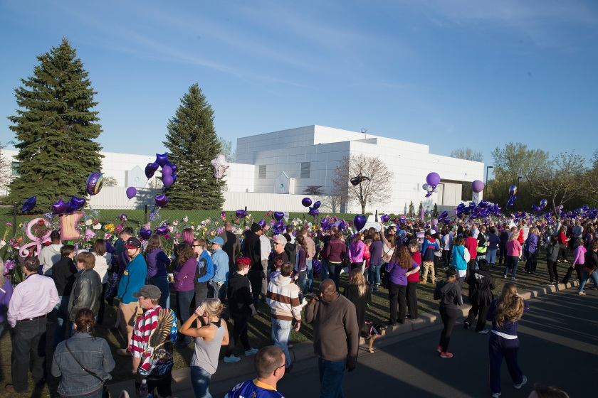 Music fans visit a memorial outside Paisley Park, the home and studio of Prince, on April 22, 2016 in Chanhassen, Minnesota. Prince, 57, was pronounced dead shortly after being found unresponsive at Paisley Park. (Scott Olson/Getty Images)
