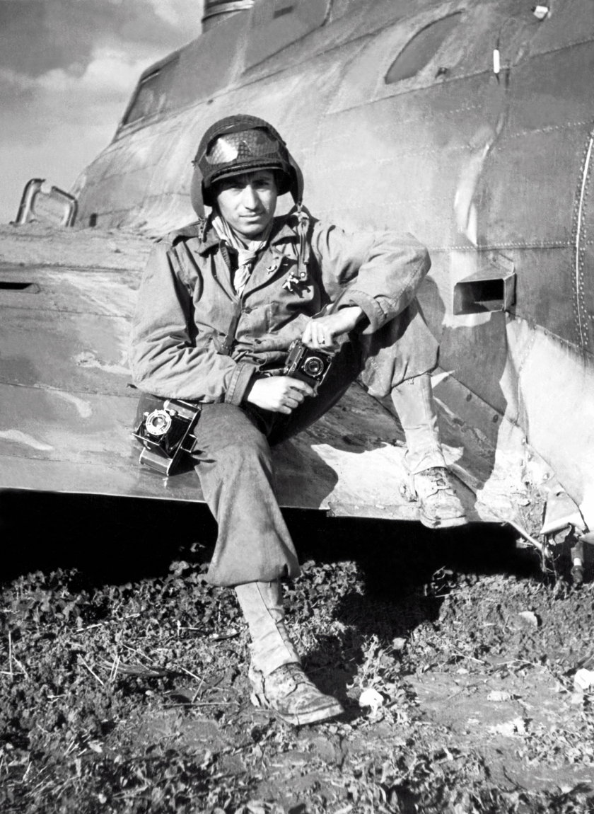 Photographer and GI Tony Vaccaro sits on the wing of a downed B-17 Flying Fortress, Mondorf-Les-Bains, Luxembourg, World War II, September 1944. (Anthony Montana/Tony Vaccaro/Getty Images)