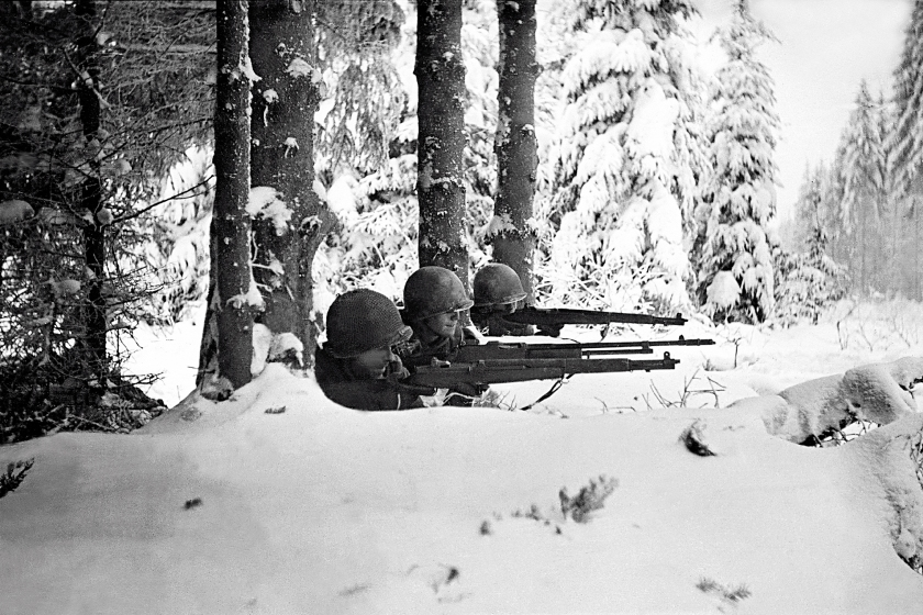 Three US infantrymen in the snow during the Battle of the Bulge, Ardennes, Belgium, World War II, January 1945. (Tony Vaccaro/Getty Images)