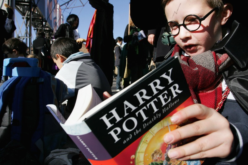 "Harry Potter fans rush to read the opening lines of the new and final novel by author J.K. Rowling, ""Harry Potter and the Deathly Hallows"" during a fans day at The Carriage Works on July 21, 2007 in Sydney, Australia. (Lisa Maree Williams/Getty Images)"