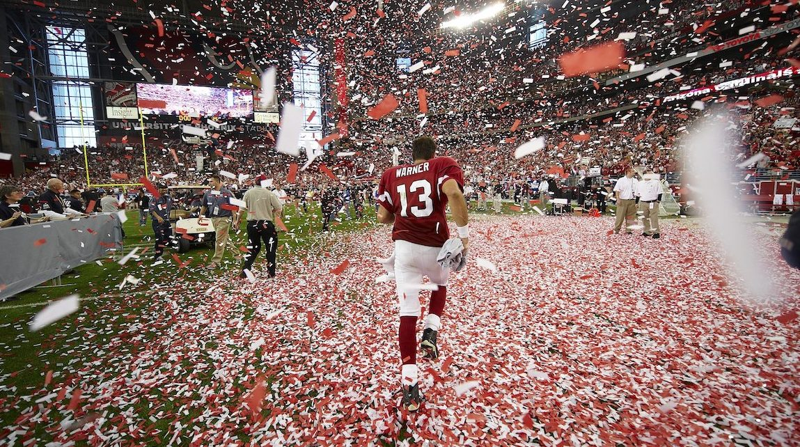 Football: NFC Playoffs: Rear view of Arizona Cardinals QB Kurt Warner (13) victorious, walking through confetti after winning NFC Champhionship game vs Philadelphia Eagles. Glendale, AZ 1/18/2009 CREDIT: Al Tielemans (Photo by Al Tielemans /Sports Illustrated/Getty Images) (Set Number: X81689 TK1 R7 F108 )