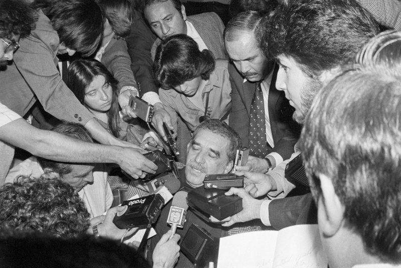 (Original Caption) 3/26/1981- Mexico City, Mexico: Colombian left-wing novelist Gabriel Garcia Marquez is surrounded by Mexican newsmen with tape recorders and microphones after his arrival at Mexico City's international airport, 3/26. Garcia Marquez is here because he fears arrest and interrogation by Colombian military officials but said he is not a political person.