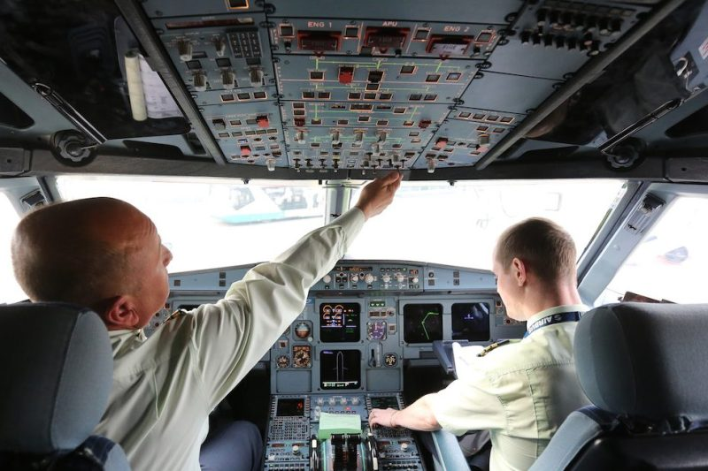 Pilots operate flight control systems in the cockpit of an Airbus A319 passenger jet operated by S7 at Domededovo airport in Moscow, Russia, on Wednesday, Oct. 26, 2016. S7, also known as Siberian Airlines, will become first Russian airline to get new Boeing Co. jets in Sept. 2018, Vedomosti reported. Photographer: Andrey Rudakov/Bloomberg