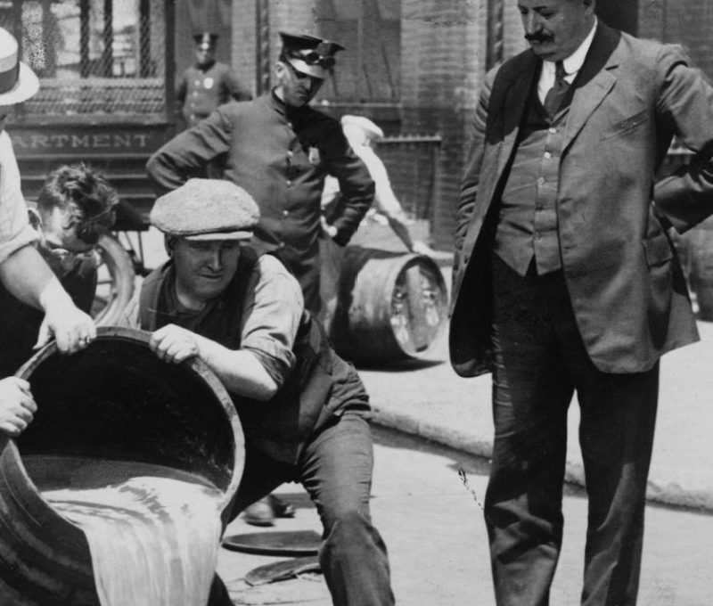 UNSPECIFIED - CIRCA 1754: Prohibition in the USA 1920-1933: A barrel of confiscated illegal beer being poured down a drain. Alcohol Temperance America (Photo by Universal History Archive/Getty Images)