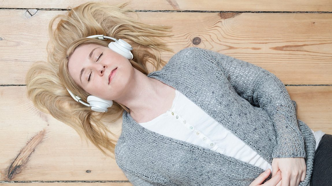 Woman Relaxing with Headphones on