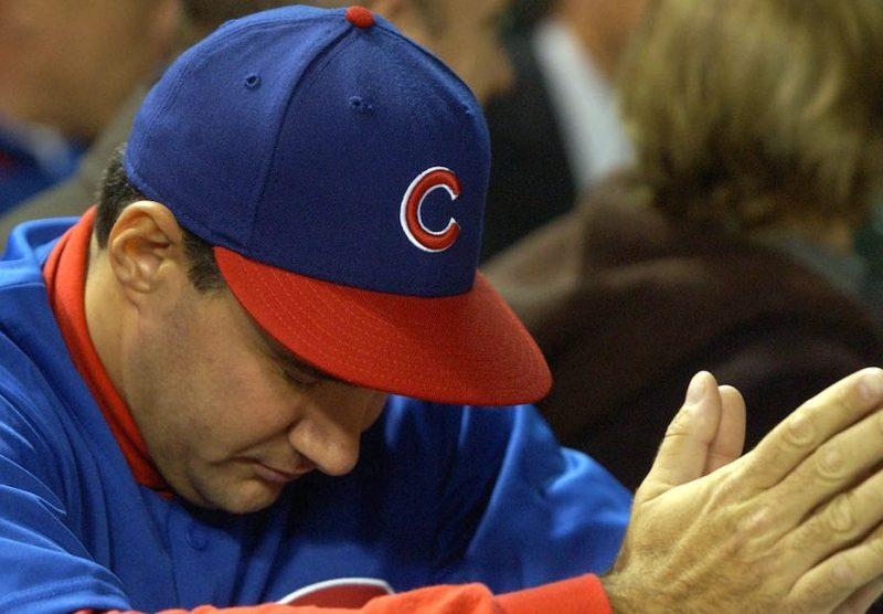 CHICAGO - OCTOBER 15: An fan waits for the final outs between the Florida Marlins and the Chicago Cubs during game seven of the National League Championship Series October 15, 2003 at Wrigley Field in Chicago, Illinois. The marlins defeated the Cubs 9-6. (Photo by Jonathan Daniel/Getty Images)
