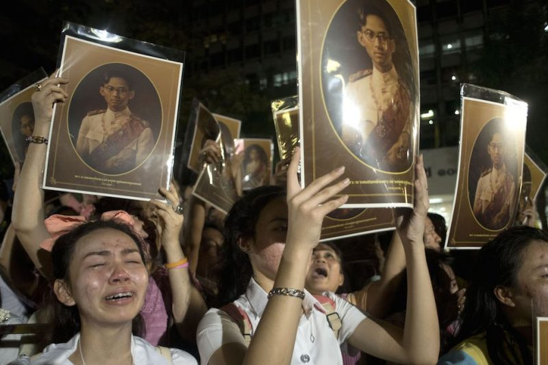 BANGKOK, THAILAND - OCTOBER 13: People mourn after learning of the death of Thailand's King Bhumibol Adulyadej on October 13, 2016 in Bangkok, Thailand. King Bhumibol, the world's longest reigning monarch, died at 88 in Bangkok's Siriraj Hospital on Thursday. (Photo by Borja Sanchez Trillo/Getty Images)
