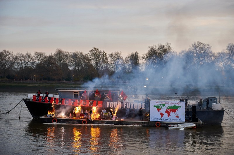 Son of Vivienne Westwood and Sex Pistols creator Malcolm McLaren, Joe Corre, burns his collection of punk memorabilia on a boat moored on the river Thames next to Chelsea Embankment in London (NIKLAS HALLE'N/AFP/Getty Images)