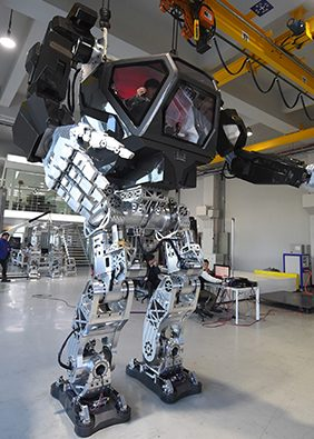 """Engineers test a 13-foot-tall humanoid manned robot dubbed Method-2 in a lab of the Hankook Mirae Technology in Gunpo, south of Seoul, on December 27, 2016. The giant human-like robot bears a striking resemblance to the military robots starring in the movie """"Avatar"""" and is claimed as a world first by its creators from a South Korean robotic company.  (JUNG YEON-JE/AFP/Getty Images)"""