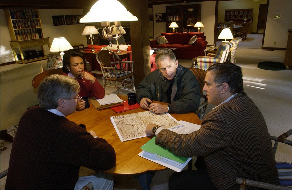 President George W. Bush receives a briefing during a meeting with CIA Director George Tenet, right, National Security Advisor Condoleezza Rice, and Chief of Staff Andy Card at Camp David, Saturday, 29 September 2001. (White House/Eric Draper)