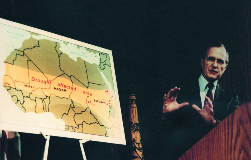 Vice President George H.W. Bush speaks while in front of a CIA map illustrating the drought in Africa in 1985. (Central Intelligence Agency)