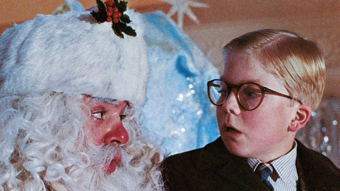 Peter Billingsley sits on Santa's lap in a scene from the film 'A Christmas Story', 1983. (Photo by Metro-Goldwyn-Mayer/Getty Images)