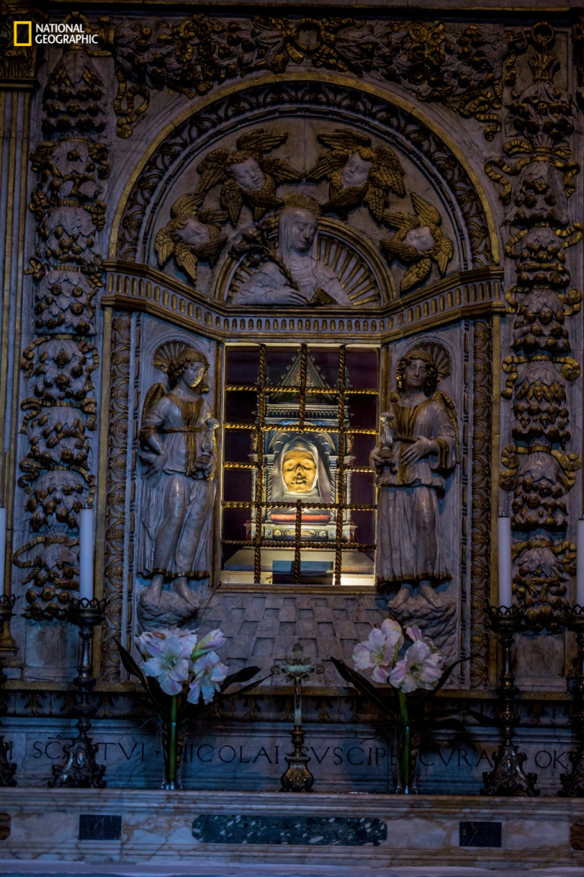 """In Siena, Italy, at the Basilica Cateriniana San Domenico, the shrine of St. Catherine, which includes her mummified head, beckons to Roman Catholic pilgrims seeking cures. """"If you have doubt,"""" says local guide Chiara Biccellari, """"you will receive nothing."""" (Erika Larsen/National Geographic)"""