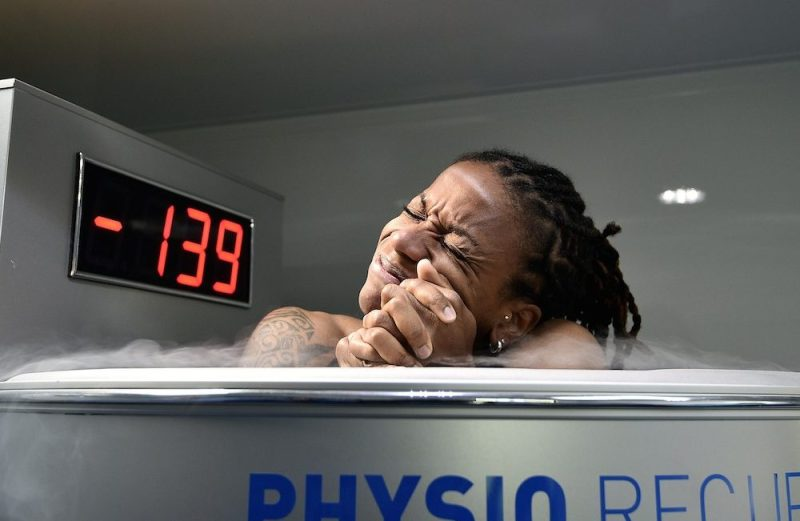 France's midfielder Elodie Thomis reacts as she undergoes treatment in a medical device used for cryotherapy at the French national football team training base in Clairefontaine-en-Yvelines, on May 11, 2015, during preparations for the upcoming FIFA 2015 Women's World Cup. AFP PHOTO / FRANCK FIFE --FRANCE OUT-- (Photo credit should read FRANCK FIFE/AFP/Getty Images)