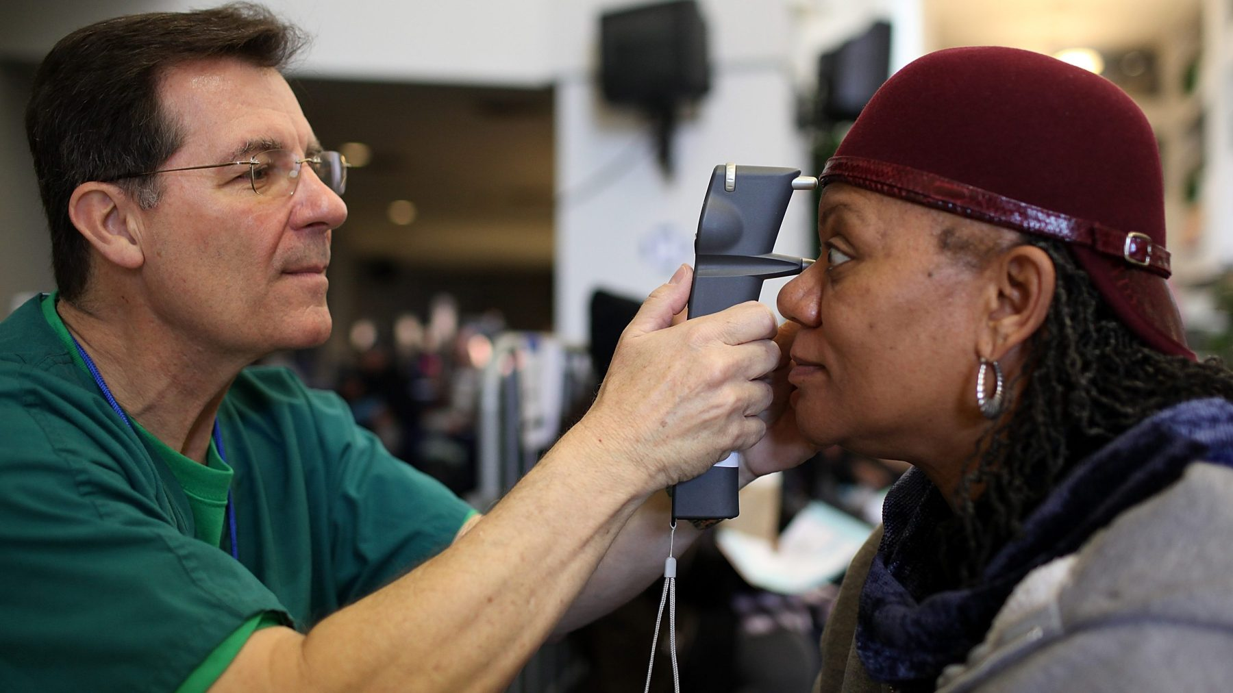 Mary Sanders (R) has her eyes examined by a Remote Area Medical (RAM) volunteer optometrist John Weis during a free clinic held at the Oakland-Alameda County Coliseum on April 11, 2011 in Oakland, California. (Justin Sullivan/Getty Images)