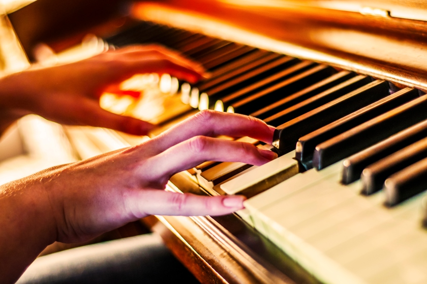 A person's hands are shown in the midst of playing the piano (Getty Images)