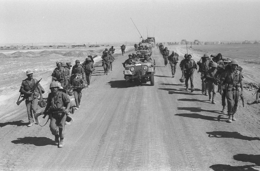 Israeli paratroopers march October 25, 1973 along the Suez-Cairo road on the western bank of the Suez Canal during the Yom Kippur War. Current Israeli Prime Minister Ariel Sharon, then a general in the Israeli army, refused to rule out another surprise attack similar to the one launched by the Arab armies when they struck against Israeli troops in the Sinai Desert and Golan Heights on the holiest day of the Jewish calendar on October 6, 1973. (Ilan Ron/GPO/Getty Images)