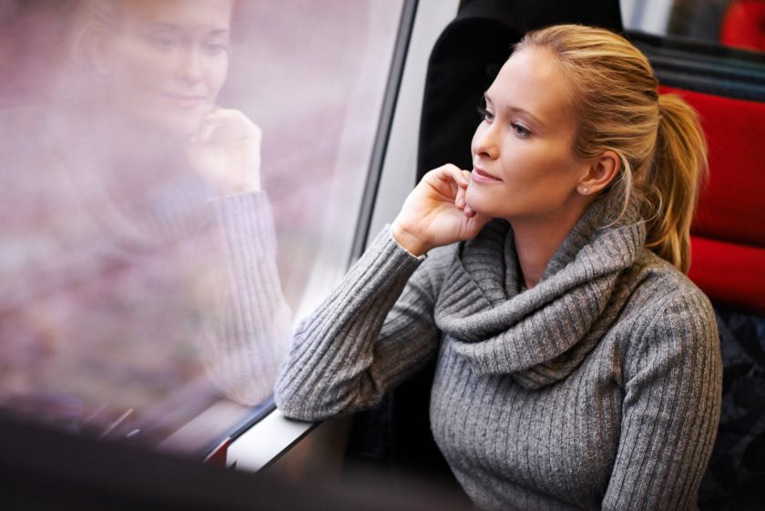 Cropped shot of an attractive young woman traveling by train