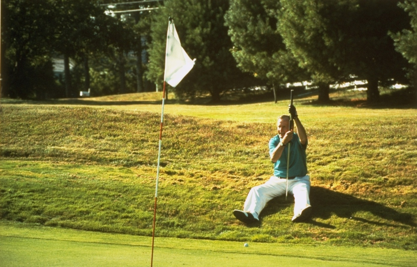 President George Bush laying on ground lining up golf putt. (David Valdez/White House/The LIFE Picture Collection/Getty Images)